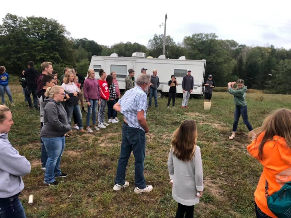 Youth group meeting, hitting golf balls