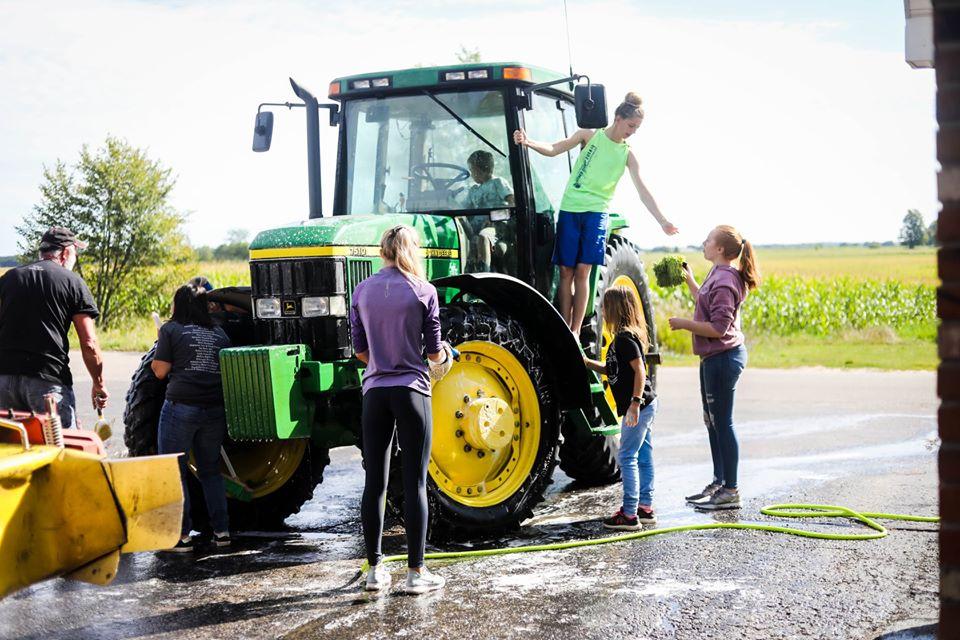 kids washing tractor